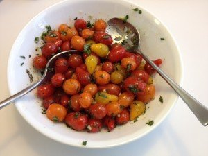 Tomatoes tossed with oil, garlic, basil